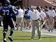 Sep 14, 2013; Durham, NC, USA; Duke Blue Devils head coach David Cutcliffe welcomes guard Laken Tomlinson (77) off the field after they scored against the Georgia Tech Yellow Jackets at Wallace Wade Stadium. Mandatory Credit: Mark Dolejs-USA TODAY Sports