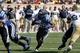 Sep 14, 2013; Durham, NC, USA; Duke Blue Devils running back Jela Duncan (25) runs the ball against the Georgia Tech Yellow Jackets at Wallace Wade Stadium. Mandatory Credit: Mark Dolejs-USA TODAY Sports