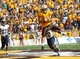 Sep 14, 2013; Laramie, WY, USA; Wyoming Cowboys wide receiver Dominic Rufran (33) scores a touchdown in front of Northern Colorado Bears cornerback Emanuel Hamilton (20) during the second half at War Memorial Stadium. Mandatory Credit: Troy Babbitt-USA TODAY Sports
