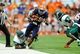 Sep 14, 2013; Syracuse, NY, USA; Syracuse Orange wide receiver Jeremiah Kobena (25) runs with the ball between Wagner Seahawks defensive end Mike Mentor (92) and defensive back Deangelo James (9) during the second quarter at the Carrier Dome.  Mandatory Credit: Rich Barnes-USA TODAY Sports