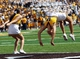 Sep 14, 2013; Laramie, WY, USA; Wyoming Cowboys cheerleaders celebrate a touchdown against the Northern Colorado Bears during the second half at War Memorial Stadium. Mandatory Credit: Troy Babbitt-USA TODAY Sports