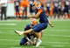 Sep 14, 2013; Syracuse, NY, USA; Syracuse Orange kicker Ryan Norton (12) kicks an extra point from the hold of quarterback Charley Loeb (17) during the third quarter at the Carrier Dome.  Syracuse defeated Wagner 54-0.  Mandatory Credit: Rich Barnes-USA TODAY Sports