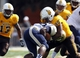 Sep 14, 2013; Laramie, WY, USA; Wyoming Cowboys defensive end Uso Olive (90) tackles Northern Colorado Bears running back Darius Graham (26) during the second quarter at War Memorial Stadium. Mandatory Credit: Troy Babbitt-USA TODAY Sports