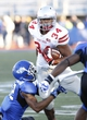 Sep 14, 2013; Buffalo, NY, USA; Buffalo Bulls defensive back Najja Johnson (22) tackles Stony Brook Seawolves running back Marcus Coker (34) during the second half at University of Buffalo Stadium. Buffalo beats Stony Brook 26-23 in OT. Mandatory Credit: Kevin Hoffman-USA TODAY Sports