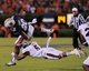 Sep 14, 2013; Auburn, AL, USA; Auburn Tigers running back Corey Grant (20) is brought down by Mississippi State Bulldogs defensive back Jamerson Love (5) at Jordan Hare Stadium. Mandatory Credit: Shanna Lockwood-USA TODAY Sports