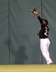 Sep 14, 2013; Pittsburgh, PA, USA; Pittsburgh Pirates center fielder Andrew McCutchen (22) catches a ball at the wall off the bat of Chicago Cubs catcher Welington Castillo (not pictured) during the fifth inning at PNC Park. The Pittsburgh Pirates won 2-1. Mandatory Credit: Charles LeClaire-USA TODAY Sports