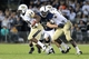 Sep 14, 2013; University Park, PA, USA; Penn State Nittany Lions defensive end C.J. Olaniyan (86) attempts to tackle Central Florida Knights running back William Stanback (28) during the fourth quarter at Beaver Stadium. Central Florida defeated Penn State 34-31. Mandatory Credit: Matthew O'Haren-USA TODAY Sports