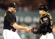 Sep 14, 2013; Pittsburgh, PA, USA; Pittsburgh Pirates relief pitcher Mark Melancon (35) and catcher Russell Martin (55) celebrate after defeating the Chicago Cubs at PNC Park. The Pittsburgh Pirates won 2-1. Mandatory Credit: Charles LeClaire-USA TODAY Sports