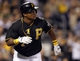 Sep 14, 2013; Pittsburgh, PA, USA; Pittsburgh Pirates right fielder Marlon Byrd (2) watches his solo home run clear the fence against the Chicago Cubs during the seventh inning at PNC Park. The Pittsburgh Pirates won 2-1. Mandatory Credit: Charles LeClaire-USA TODAY Sports
