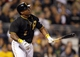 Sep 14, 2013; Pittsburgh, PA, USA; Pittsburgh Pirates right fielder Marlon Byrd (2) hits a solo home run against the Chicago Cubs during the seventh inning at PNC Park. The Pittsburgh Pirates won 2-1. Mandatory Credit: Charles LeClaire-USA TODAY Sports