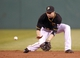 Sep 14, 2013; Pittsburgh, PA, USA; Pittsburgh Pirates second baseman Neil Walker (18) fields a ground ball against the Chicago Cubs during the eighth inning at PNC Park. The Pittsburgh Pirates won 2-1. Mandatory Credit: Charles LeClaire-USA TODAY Sports