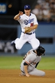 Sep 14, 2013; Los Angeles, CA, USA; Los Angeles Dodgers second baseman Mark Ellis (14) forces out San Francisco Giants first baseman Brandon Belt (9) during the third inning at Dodger Stadium. Mandatory Credit: Kelvin Kuo-USA TODAY Sports