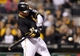 Sep 14, 2013; Pittsburgh, PA, USA; Pittsburgh Pirates right fielder Jose Tabata (31) hits a solo home run against the Chicago Cubs during the sixth inning at PNC Park. The Pittsburgh Pirates won 2-1. Mandatory Credit: Charles LeClaire-USA TODAY Sports