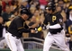 Sep 14, 2013; Pittsburgh, PA, USA; Pittsburgh Pirates third base coach Nick Leyva (left) greets Pittsburgh Pirates right fielder Jose Tabata (31) after Tabata hit a solo home ruin against the Chicago Cubs during the sixth inning at PNC Park. The Pittsburgh Pirates won 2-1. Mandatory Credit: Charles LeClaire-USA TODAY Sports