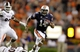 Sep 14, 2013; Auburn, AL, USA; Auburn Tigers quarterback Nick Marshall (14) avoids Mississippi State Bulldog defenders during the fourth quarter at Jordan Hare Stadium.  The Tigers beat the Bulldogs 24-20.  Mandatory Credit: John Reed-USA TODAY Sports