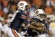 Sep 14, 2013; Auburn, AL, USA; Auburn Tigers quarterback Nick Marshall (14) hands off to running back Corey Grant (2) during the second half against the Mississippi State Bulldogs at Jordan Hare Stadium.  The Tigers beat the Bulldogs 24-20.  Mandatory Credit: John Reed-USA TODAY Sports