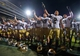 Sep 14, 2013; West Lafayette, IN, USA; Notre Dame Fighting Irish cornerback Bennett Jackson (2) and linebacker Jarrett Grace (59) celebrate with their teammates after Notre Dame defeated the Purdue Boilermakers 31-24 at Ross-Ade Stadium. Mandatory Credit: Matt Cashore-USA TODAY Sports