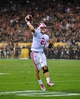 Sep 14, 2013; Tempe, AZ, USA; Wisconsin Badgers quarterback Joel Stave (2) throws a two yard touchdown during the first half against the Arizona State Sun Devils at Sun Devil Stadium. Mandatory Credit: Matt Kartozian-USA TODAY Sports