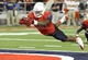 Sep 14, 2013; Tucson, AZ, USA; Arizona Wildcats running back KaDeem Carey (25) scores a touchdown that was later called back because of an illegal formation during the fourth quarter against the Texas-San Antonio Roadrunners at Arizona Stadium. The Wildcats defeated the Roadrunners 38-13. Mandatory Credit: Casey Sapio-USA TODAY Sports
