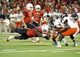 Sep 14, 2013; Tucson, AZ, USA; Arizona Wildcats running back KaDeem Carey (25) dives forward with the ball as he is pursued by Texas-San Antonio Roadrunners safety Triston Wade (7) during the third quarter at Arizona Stadium. The Wildcats defeated the Roadrunners 38-13. Mandatory Credit: Casey Sapio-USA TODAY Sports