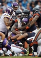 Sep 15, 2013; Chicago, IL, USA; Minnesota Vikings running back Adrian Peterson (28) is tackled by members of the Chicago Bears defense during the fourth quarter at Soldier Field. The Bears won 31-30. Mandatory Credit: Jerry Lai-USA TODAY Sports