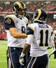 Sep 15, 2013; Atlanta, GA, USA; St. Louis Rams wide receiver Tavon Austin (11) celebrates with quarterback Sam Bradford (8) after a touchdown in the second half against the Atlanta Falcons at the Georgia Dome. The Falcons won 31-24. Mandatory Credit: Daniel Shirey-USA TODAY Sports