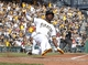Sep 15, 2013; Pittsburgh, PA, USA; Pittsburgh Pirates center fielder Andrew McCutchen (22) slides across home plate with the game winning run against the Chicago Cubs during the eighth inning at PNC Park. The Pittsburgh Pirates won 3-2. Mandatory Credit: Charles LeClaire-USA TODAY Sports