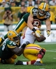 Sep 15, 2013; Green Bay, WI, USA;  Washington Redskins quarterback Robert Griffin III (10) is sacked by Green Bay Packers linebacker Clay Matthews (52) and defensive end Mike Daniels (76) in the fourth quarter at Lambeau Field. Mandatory Credit: Benny Sieu-USA TODAY Sports