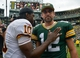 Sep 15, 2013; Green Bay, WI, USA;  Green Bay Packers quarterback Aaron Rodgers (12) and Washington Redskins quarterback Robert Griffin III (10)meet at the field after the game at Lambeau Field. The Packers beat the Redskins 38-20. Mandatory Credit: Benny Sieu-USA TODAY Sports
