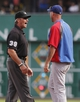 Sep 15, 2013; Pittsburgh, PA, USA; Umpire Paul Nauert (39) talks to Chicago Cubs manager Dale Sveum (right) after a close play at first base against the Pittsburgh Pirates during the ninth inning at PNC Park. The Pittsburgh Pirates won 3-2. Mandatory Credit: Charles LeClaire-USA TODAY Sports