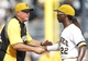 Sep 15, 2013; Pittsburgh, PA, USA; Pittsburgh Pirates manager Clint Hurdle (left) greets center fielder Andrew McCutchen (22) after defeating the Chicago Cubs at PNC Park. The Pittsburgh Pirates won 3-2. Mandatory Credit: Charles LeClaire-USA TODAY Sports