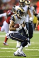 Sep 15, 2013; Atlanta, GA, USA; St. Louis Rams wide receiver Austin Pettis (18) runs with the ball against the Atlanta Falcons during the second half at Georgia Dome. The Falcons defeated the Rams 31-24. Mandatory Credit: Dale Zanine-USA TODAY Sports