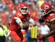 Sep 15, 2013; Kansas City, MO, USA; Kansas City Chiefs quarterback Alex Smith (11) hands off the ball to running back Jamaal Charles (25) during the second half of the game against the Dallas Cowboys at Arrowhead Stadium. The Chiefs won 17-16. Mandatory Credit: Denny Medley-USA TODAY Sports