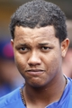 Sep 15, 2013; Pittsburgh, PA, USA; Chicago Cubs shortstop Starlin Castro (13) stands in the dugout against the Pittsburgh Pirates during the seventh inning at PNC Park. The Pittsburgh Pirates won 3-2. Mandatory Credit: Charles LeClaire-USA TODAY Sports