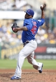 Sep 15, 2013; Pittsburgh, PA, USA; Chicago Cubs relief pitcher Pedro Strop (46) pitches against the Pittsburgh Pirates during the eighth inning at PNC Park. The Pittsburgh Pirates won 3-2. Mandatory Credit: Charles LeClaire-USA TODAY Sports