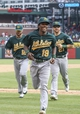 Sep 15, 2013; Arlington, TX, USA; Oakland Athletics second baseman Jemile Weeks (19) runs into the dugout with second baseman Andy Parrino (12) and catcher Stephen Vogt (21) after the victory over the Texas Rangers at Rangers Ballpark in Arlington. Mandatory Credit: Kevin Jairaj-USA TODAY Sports