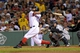 Sep 15, 2013; Boston, MA, USA; Boston Red Sox first baseman Mike Napoli (12) hits a two run home run during the first inning against the New York Yankees at Fenway Park. Mandatory Credit: Bob DeChiara-USA TODAY Sports