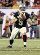 Sep 15, 2013; Tampa, FL, USA; New Orleans Saints quarterback Drew Brees (9) looks down the field to throw the ball with less then a minute left during the fourth quarter against the Tampa Bay Buccaneers at Raymond James Stadium. The Saints won 16-14. Mandatory Credit: Kim Klement-USA TODAY Sports