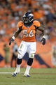Sep 5, 2013; Denver, CO, USA; Denver Broncos linebacker Nate Irving (56) during the game against the Baltimore Ravens at Sports Authority Field at Mile High. Mandatory Credit: Ron Chenoy-USA TODAY Sports
