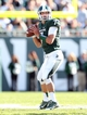 Sep 14, 2013; East Lansing, MI, USA; Michigan State Spartans quarterback Tyler O'Connor (7) attempts to pass the ball during the second half in a game between the Michigan State Spartans and the Youngstown State Penguins  at Spartan Stadium. MSU won 55-17.Mandatory Credit: Mike Carter-USA TODAY Sports