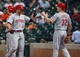 Sep 16, 2013; Houston, TX, USA; Cincinnati Reds shortstop Zack Cozart (2) is congratulated by right fielder Jay Bruce (32) after hitting a home run during the second inning against the Houston Astros at Minute Maid Park. Mandatory Credit: Troy Taormina-USA TODAY Sports