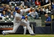 Sep 16, 2013; Milwaukee, WI, USA;  Chicago Cubs shortstop Starlin Castro hits a double in the third inning against the Milwaukee Brewers at Miller Park. Mandatory Credit: Benny Sieu-USA TODAY Sports