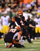 Sep 16, 2013; Cincinnati, OH, USA; Cincinnati Bengals kicker Mike Nugent (2) kicks a field goal during the fourth quarter against the Pittsburgh Steelers at Paul Brown Stadium. Mandatory Credit: Andrew Weber-USA TODAY Sports