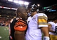 Sep 16, 2013; Cincinnati, OH, USA; Cincinnati Bengals outside linebacker James Harrison (92) hugs Pittsburgh Steelers quarterback Ben Roethlisberger (7) after the Cincinnati Bengals defeated the Pittsburgh Steelers 20-10 at Paul Brown Stadium. Mandatory Credit: Andrew Weber-USA TODAY Sports