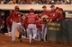 Sep 16, 2013; Oakland, CA, USA; Los Angeles Angels right fielder Kole Calhoun (56) high fives teammates after scoring a run against the Oakland Athletics during the fifth inning at O.co Coliseum. Mandatory Credit: Kelley L Cox-USA TODAY Sports