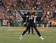 Sep 16, 2013; Cincinnati, OH, USA; Cincinnati Bengals quarterback Andy Dalton (14) throws a pass in the game against the Pittsburgh Steelers at Paul Brown Stadium. Cincinnati won the game 20-10. Mandatory Credit: Greg Bartram-USA TODAY Sports