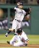 Sep 17, 2013; Pittsburgh, PA, USA; San Diego Padres shortstop Ronny Cedeno (top) leaps after forcing out Pittsburgh Pirates catcher Russell Martin (55) at second base during the second inning at PNC Park. Mandatory Credit: Charles LeClaire-USA TODAY Sports