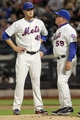 Sep 17, 2013; New York, NY, USA; New York Mets pitching coach Dan Warthen (59) talks to New York Mets starting pitcher Zack Wheeler (45) during the second inning in the game against the San Francisco Giants at Citi Field. Mandatory Credit: Brad Penner-USA TODAY Sports