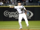 Sep 17, 2013; Chicago, IL, USA; Chicago White Sox second baseman Gordon Beckham (15) makes a throw to first base against the Minnesota Twins during the first inning at U.S Cellular Field. Mandatory Credit: Mike DiNovo-USA TODAY Sports