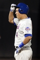 Sep 17, 2013; New York, NY, USA; New York Mets third baseman Wilmer Flores (4) reacts after hitting an RBI double against the San Francisco Giants during the fourth inning of a game at Citi Field. Mandatory Credit: Brad Penner-USA TODAY Sports